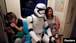 "A fan dressed as a Storm Trooper from ""Star Wars"" reacts at the Taipei Metro (MRT) during Star Wars Day in Taipei, Taiwan, May 4, 2017."