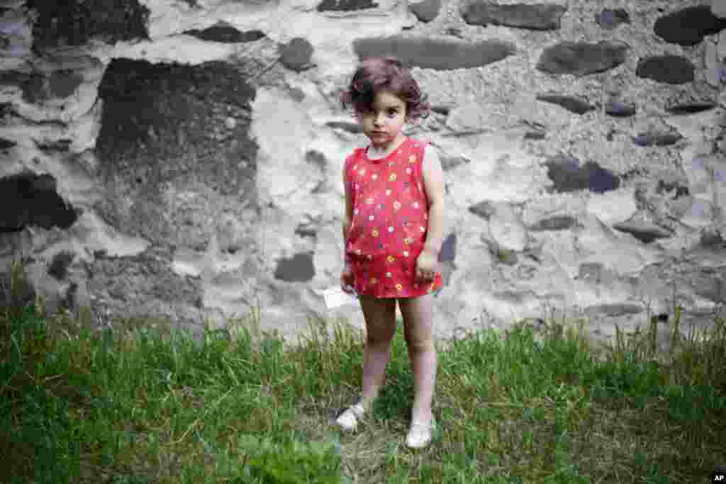 Keti Doijashvili, 3, was born on August 8, 2008 while her village was being bombed. (Yuli Weeks for VOA)