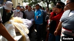 Relatives cry as the body of one of the Nepali mountaineering guides who was killed in Friday's avalanche on Mount Everest, is brought to Sherpa Monastery in Kathmandu, Apr. 19, 2014.