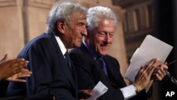 Former President Bill Clinton and Nobel Peace Prize laureate Elie Wiesel participate in an event for the 20th anniversary of the United States Holocaust Memorial Museum in Washington, April 29, 2013.