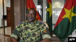 FILE - General Gilbert Diendere sits at the presidential palace in Ouagadougou, Sept. 17, 2015.