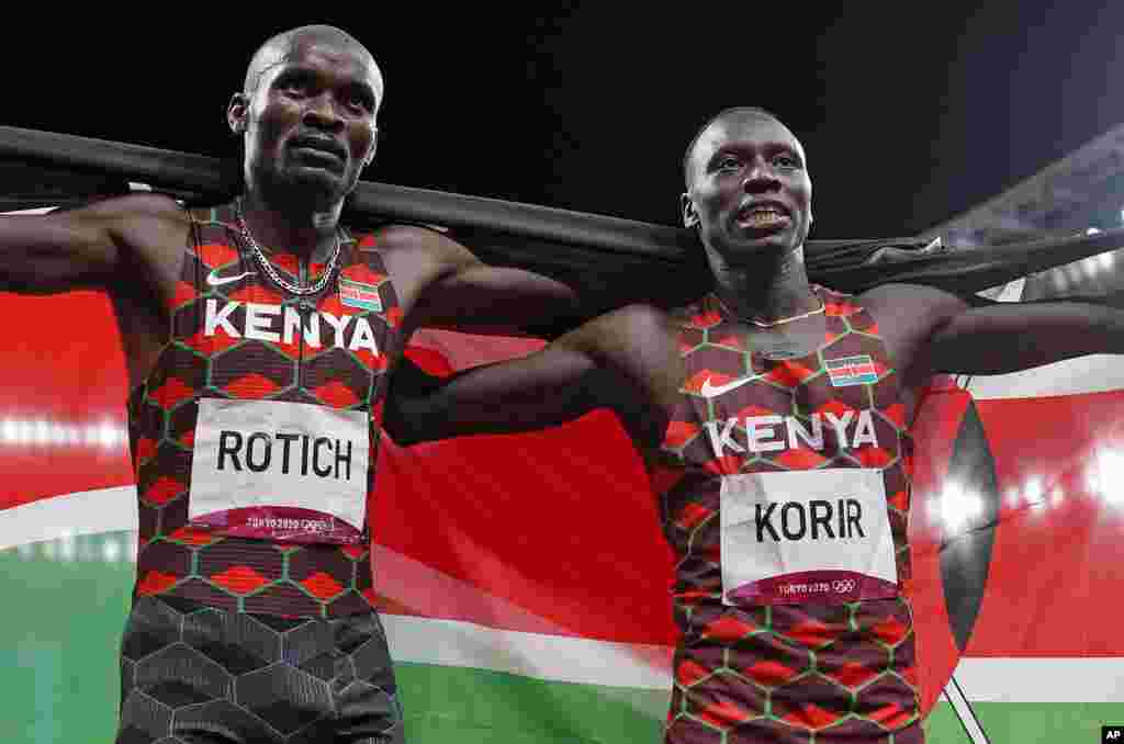 Emmanuel Korir, of Kenya, celebrates winning the gold medal ahead with Ferguson Rotich, of Kenya, silver, after the final of the men's 800-meter at the 2020 Summer Olympics, Wednesday, Aug. 4, 2021, in Tokyo, Japan. (AP Photo/Francisco Seco)