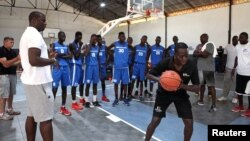 Olumide Oyedeji, a former NBA player, works with young players at the skills development station of the National Basketball Association's first training academy in Thies, east of Dakar, Senegal, May 2, 2017.