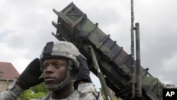 A U.S. soldier stands next to a Patriot surface-to-air missile battery at an army base in Morag, Poland, Wednesday, May 26, 2010. Polish and U.S. officials hailed the arrival in Poland of an American Patriot missile battery, saying Wednesday that the hard