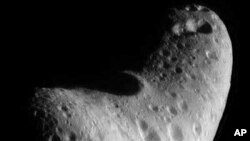 This image of another near-Earth asteroid 433 Eros reveals that its ancient surface has been scarred by numerous collisions with other small objects
