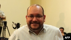FILE - Iranian-American Washington Post correspondent Jason Rezaian. Iran said Sunday it has sentenced detained Rezaian to an unspecified prison term following his conviction last month on espionage charges.