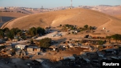 FILE - A general view shows the main part of the Palestinian Bedouin encampment of Khan al-Ahmar village that Israel plans to demolish, in the occupied West Bank, Sept. 11, 2018.