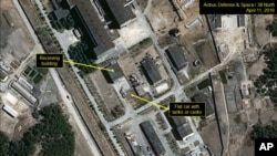 In this image provided by 38 North, shows a rail flatcar at radiochemical laboratory where North Korea separates weapons-grade plutonium from waste from a nuclear reactor. U.S. researchers see further signs from satellite imagery that North Korea is looki