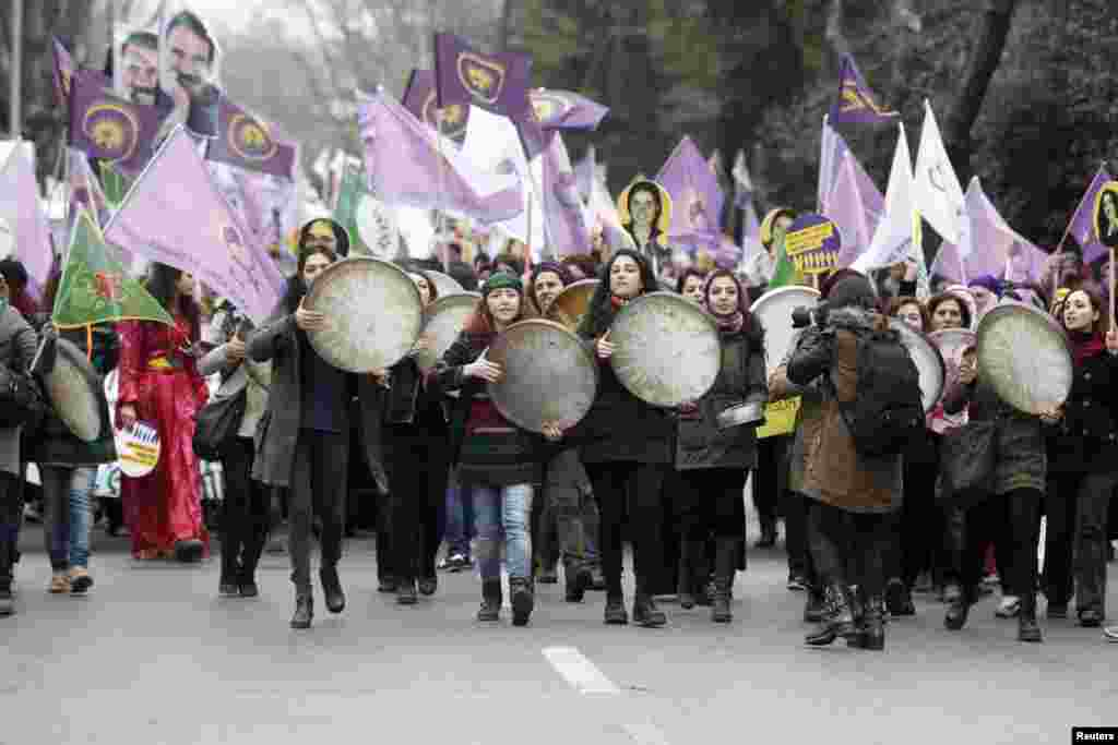 Women walk as they shout slogans during an International Women's Day rally in Istanbul, Turkey, March 8, 2015.