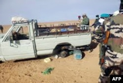 FILE - A picture taken with a mobile phone Oct. 30, 2013 and received on Nov. 2, 2013 shows one of the trucks that was carrying some of 92 migrants who died of thirst in the harsh Niger desert, about a dozen kilometers from the Algerian border.
