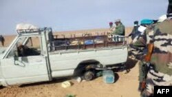 FILE - A picture taken with a mobile phone Oct. 30, 2013, shows one of the trucks carrying some 92 migrants traveling through the Niger desert. Niger's security forces on Saturday arrested more than 100 people trying to illegally cross into Algeria, sources said Monday.