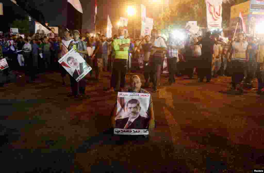A Morsi supporter sits during an anti-army rally in Nasr City, July 30, 2013.