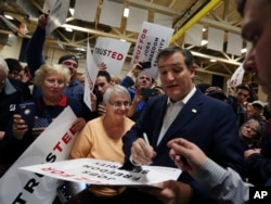 Republican presidential candidate, Sen. Ted Cruz, R-Texas, signs posters for his supporters at a campaign rally in Rochester, New York, April 15, 2016.