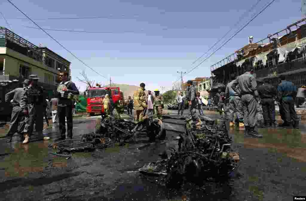 Afghan police stand guard at the site of a suicide attack in Kabul, May 16, 2013.