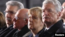 (R-L) German Pres. Joachim Gauck, Chancellor Angela Merkel and Norbert Lammert, Pres. of Germany's lower house of parliament Bundestag attend a service at Berlin's Memorial church to commemorate the 12 killed victims of a truck that ploughed into a crowded Christmas market at Breitscheidplatz, Berlin, Dec. 20, 2016.