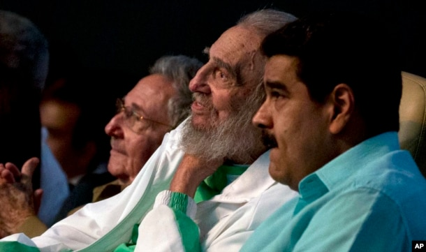 Cuban Leader Fidel Castro, center, attends a gala for his 90th birthday, Aug. 13, 2016, accompanied by Cuba's President Raul Castro, left, and Venezuela's President Nicolas Maduro, right, at the Karl Marx theater in Havana, Cuba.