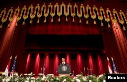 U.S. President Barack Obama speaks in the Grand Hall of Cairo University in Cairo June 4, 2009.