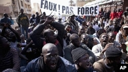 Senegalese anti-government youth rally against President Wade in the capital Dakar. Members of a Senegalese anti-government youth movement Y En A Marre (We're Fed Up) chant slogans during a rally against President Abdoulaye Wade in the capital Dakar, Janu