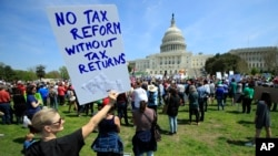 Protesters gather on Capitol Hill in Washington during a Tax Day demonstration calling on President Donald Trump to release his tax returns, April 15, 2017.