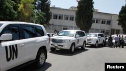 Kendaraan PBB yang membawa para pakar senjata kimia tiba di RS militer Yousef al-Azma di Damaskus, Jumat (30/8).