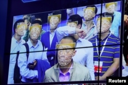 Visitors experience facial recognition technology at Face++ booth during the China Public Security Expo in Shenzhen, China, Oct. 30, 2017.