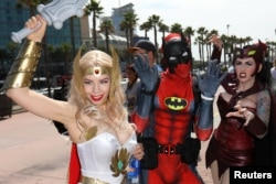 Attendees arrive dressed in costume for the opening day of Comic Con International in San Diego, California, July 20, 2017.