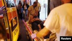 Israeli medics evacuate a man wounded in what police suspect was a Palestinian stabbing attack to Barzilai hospital in Ashkelon, Nov. 21, 2015.