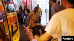 Israeli medics evacuate a man wounded in what police suspected was a Palestinian stabbing attack to Barzilai hospital in Ashkelon, Nov. 21, 2015.