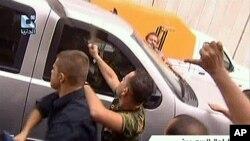 亲政府的叙利亚人9月29日在大马士革袭击美国大使馆的汽车
