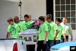 These children in Florida wearing anti-bullying t-shirts carry the casket of their classmate, Rebecca Sedwick. In 2013 at age 12, she jumped to her death after being bullied online.