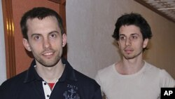 In this May 21, 2010 file photo, American hikers Shane Bauer, left, and Josh Fattal are shown in Tehran, Iran. The lawyer for two Americans jailed as spies in Iran says a $1 million bail-for-freedom deal has been approved by the courts, clearing the way f