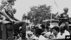 FILE - Members of the Youth Wing of the Indonesian Communist Party (Pemuda Rakjat) taken to prison in Jakarta, Oct. 30, 1965, after an abortive coup against President Sukarno's government earlier in the month.