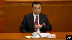 PM China Li Keqiang melaporkan hasil kerjanya pada Kongres Rakyat Nasional di Balai Agung Rakyat di Beijing, Sabtu, 5 Mar 2016