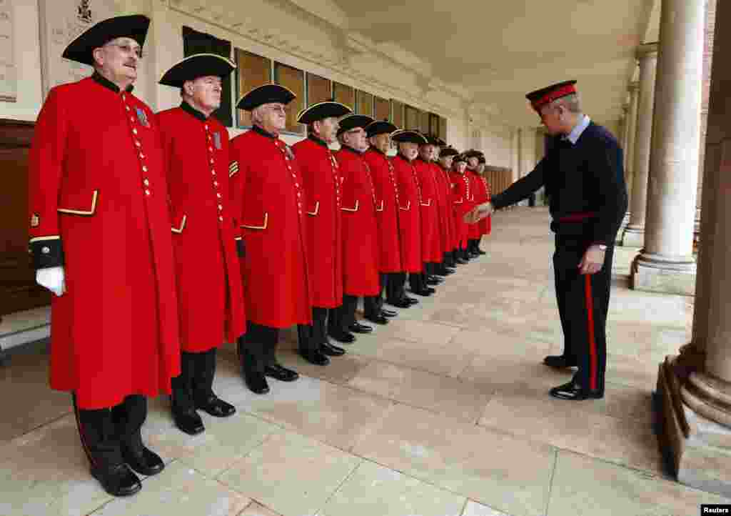 Sergeant Major Pearse Lally inspects Chelsea Pensioners, who will take part in the funeral of the late former British Prime Minister Margaret Thatcher, during a uniform inspection at the Royal Hospital Chelsea in London.
