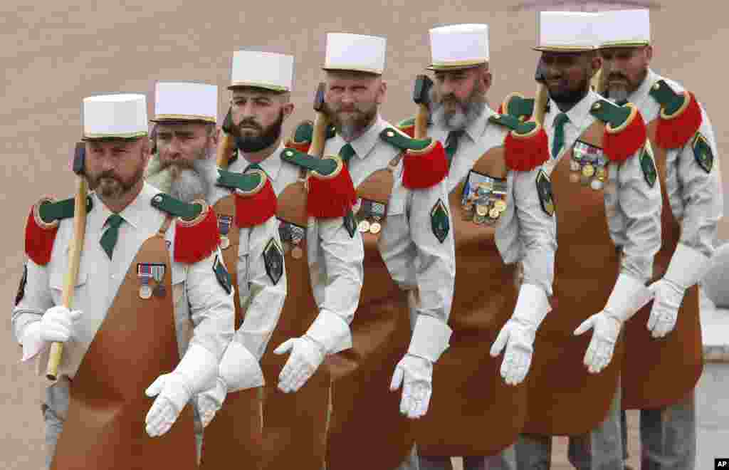 Legionnaires dressed in traditional pioneer outfits hold hatchets during the commemoration ceremony of the 1863 battle of Camerone, at the Foreign Legion base of Aubagne, near the southern city of Marseille, France.