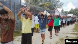 FILE - An undated image released Nov. 13, 2017, shows detainees staging a protest inside the compound at the Manus Island detention center in Papua New Guinea. (Refugee Action Coalition/Handout via Reuters)