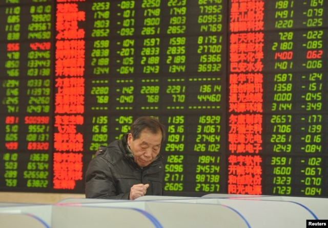 FILE - An investor looks at a computer screen showing stock information at a brokerage house in Fuyang, Anhui province, Jan. 28, 2016. Some say recent stock market turmoil will leave foreigners cautious about investing in China.