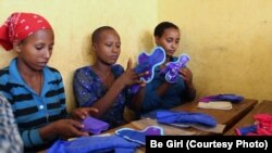 Ethiopian girls examine Be Girl's affordable, reusable feminine hygiene products. Diana Sierra developed the project at the Halcyon House incubator in Washington, D.C.