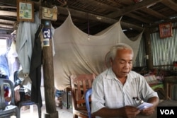 Chan Leap, 66, a district official for the opposition Cambodian National Rescue Party until it was dissolved in mid-November, sits at his house in Takeo province. He said he did not defect to the ruling Cambodian People's Party, but urged others to do so. (Sun Narin/VOA Khmer)