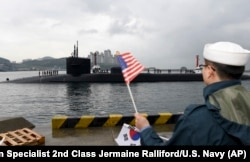 The U.S. Navy's Ohio-class guided-missile submarine USS Michigan is greeted as it arrives in Busan, South Korea, for a scheduled port visit while conducting routine patrols throughout the western Pacific, April 24, 2017.