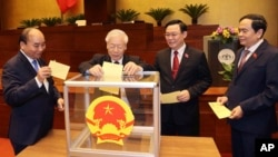 Vietnamese leaders cast ballot to elect new Prime Minister, from left, President Nguyen Xuan Phuc, Communist General Secretary Nguyen Phu Trong, Chairman of National Assembly Vuong Dinh Hue and newly elected Prime Minister Pham Minh Chinh in Hanoi, Vietnam April 5, 2021.