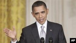 Le président Barack Obama lors de la conférence de presse à la Maison blanche avec son homologue mexicain Felipe Calderon Felipe Calderon