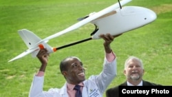 Pathologist Timothy Amukele, left, teamed with Robert Chalmers and other engineers to create a drone courier system that transports blood to diagnostic laboratories. (Credit: Johns Hopkins Medicine)