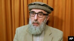 FILE - This image made from video released to the Associated Press during the week of Nov. 21, 2015, shows former Afghan warlord Gulbuddin Hekmatyar, now in his late 60s, at an undisclosed location.