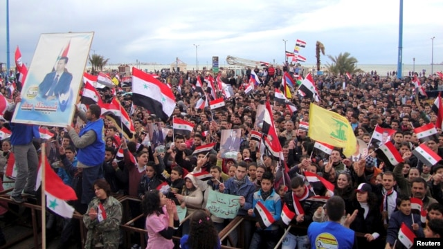 Supporters of Syria's President Bashar al-Assad attend a rally in the northern port city of Tartous, Jan. 12, 2012.