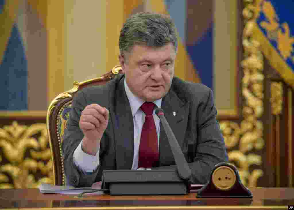 Ukrainian President Petro Poroshenko: ``(The) tragedy showed again that terrorism is not localized, but a world problem. And the external aggression against Ukraine is not just our problem, but a threat to European and global security.''
