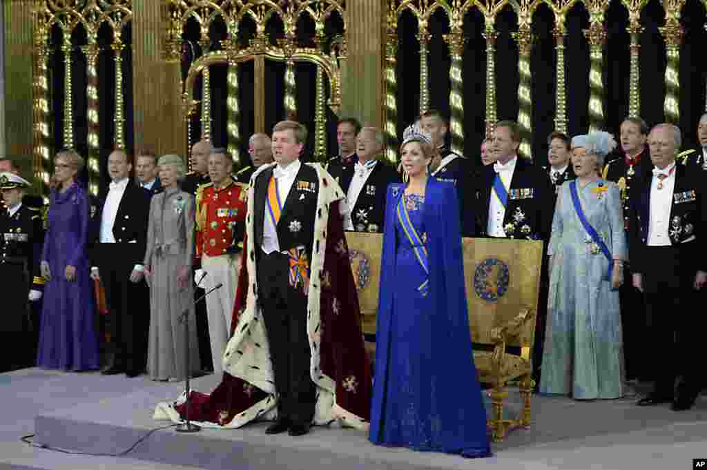 Dutch King Willem-Alexander and his wife Queen Maxima, center, sing hymns at the Nieuwe Kerk or New Church in Amsterdam, The Netherlands, prior to the inauguration of King Willem-Alexander.