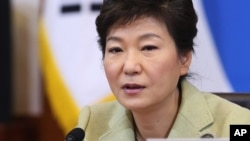 FILE - South Korean President Park Geun-hye speaks during a Cabinet Council meeting at the presidential Blue House in Seoul, South Korea, Dec. 10, 2013.
