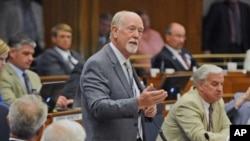 "North Dakota House Majority Leader Al Carlson speaks to members in the House in Bismarck, N.D., on Thursday, Aug. 4, 2016 during a floor debate on SB 2379. ""This is a good bill, it's not a time to play politics."" (Tom Stromme/The Bismarck Tribune via AP)"
