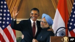 U.S. President Barack Obama, left, and Indian Prime Minister Manmohan Singh, embrace following a joint statement and press conference at Hyderabad House in New Delhi, India, Monday, Nov. 8, 2010.